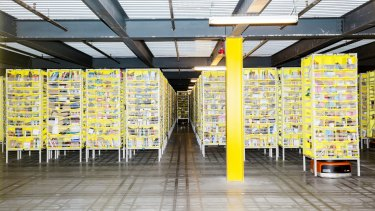 A robot fills orders inside an Amazon fulfilment centre in the US.