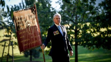 David Laird, convener of the WW I 7th Battalion association, will march in the alternative parade with the banner from his grandfather's battalion.