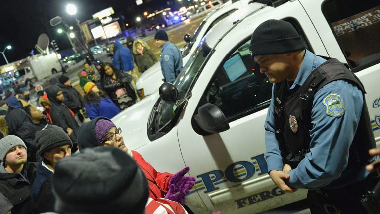 Protesters demonstrate outside the Ferguson Police Department in March.
