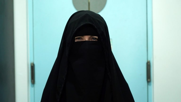"Indonesia correspondent Jewel Topsfield tries on a niqab as part of the ""Niqab Challenge"""