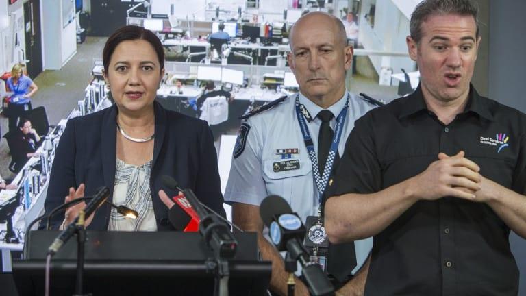 Queensland Premier Annastacia Palaszczuk speaks to the media along side the Queensland Police Service Deputy Commissioner Steve Gollschewski and Interpreter Mark Cave in the Coordination Centre in Brisbane on Friday.
