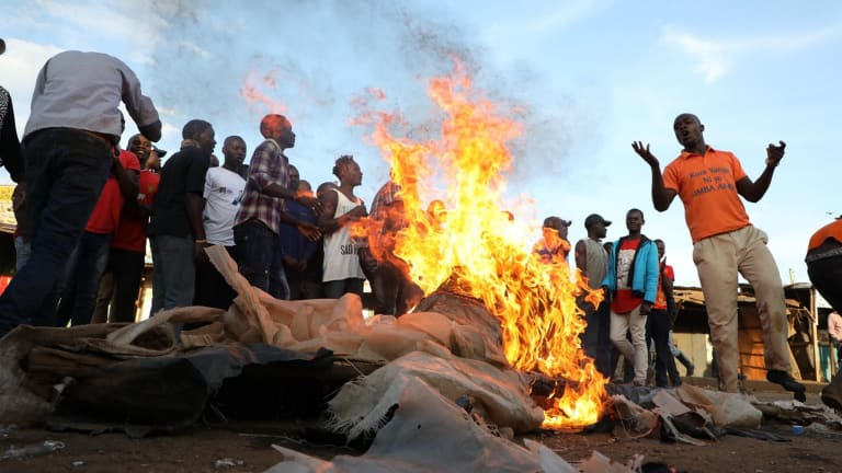 Kenyan opposition supporters burn tyres and other items in Kawangware, Nairobi on Monday.