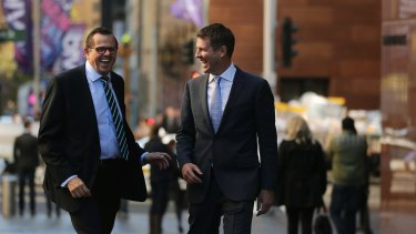 Rob Whitfield, left, famously took a massive pay cut when poached by then NSW premier Mike Baird, right, in 2015.