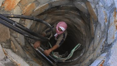 A Palestinian smuggler in a tunnel in 2008.