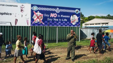 A police sign asking people to say no to Kwaso, a highly potent home-brewed spirit drink, is displayed outside the Lawson Tama Stadium in Honiara.