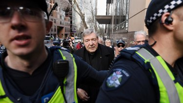 Cardinal George Pell makes the trip from his lawyers' offices to Melbourne Magistrates Court.