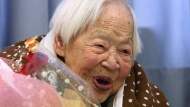 Misao Okawa, who is recognised by Guinness World Records as the world's oldest woman, reacts during her 115th birthday celebrations in 2013 in Osaka, Japan.