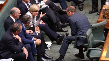 Pressure mounting: Prime Minister Tony Abbott and Foreign Affairs Minister Julie Bishop during a division in question time on Thursday.