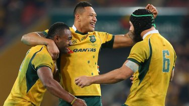 Match winner: Tevita Kuridrani, Isreal Folau and Scott Fardy rejoice at full-time.