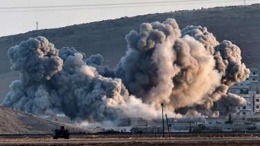 Smoke rises during air strikes on Kobane seen from the Turkish-Syrian border.