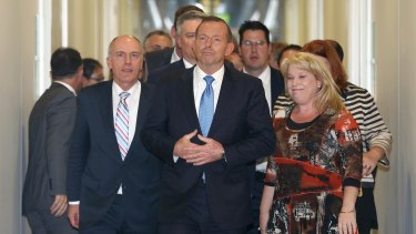 Eric Abetz departed the partyroom meeting by Tony Abbott's side after Abbott lost the leadership ballot.