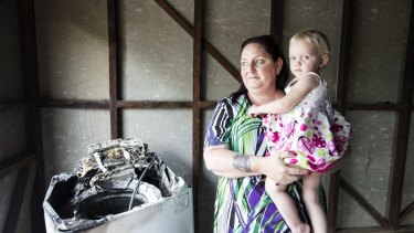 Patricia Borg, and her granddaughter Miracle, aged 2. Patricia is the owner of a Samsung washing machine that caught fire.