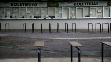 Ticket booths stand shuttered at the former Buenos Aires Zoo in Argentina on Friday.