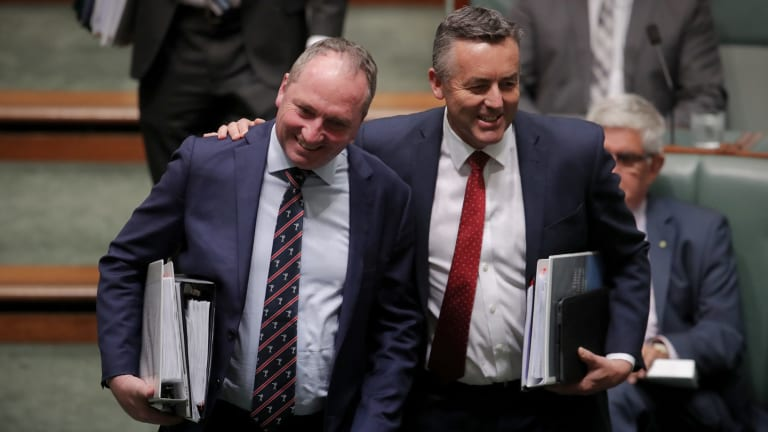 Deputy Prime Minister Barnaby Joyce and the now former infrastructure minister Darren Chester in Question Time in October.