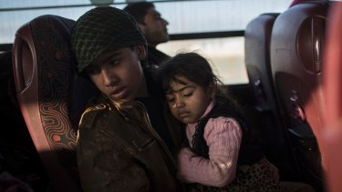 Displaced Iraqis, fleeing fighting between Iraqi security forces and Islamic State militants, ride on a bus to the Hassan Sham camp, east of Mosul, last week.