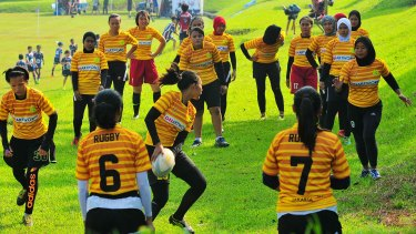 Universitas Negeri Jakarta rugby team during a training session before their match at Jagorawi Golf and Country club.
