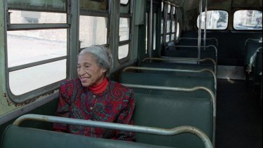 Civil rights pioneer Rosa Parks sits in a 1950s-era bus in Alabama, in this 1995 file photo, 40 years after she was arrested for refusing to give up her seat on a city bus to a white person.