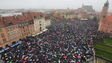 A sea of umbrellas on Black Monday in downtown Castle Square, Warsaw.