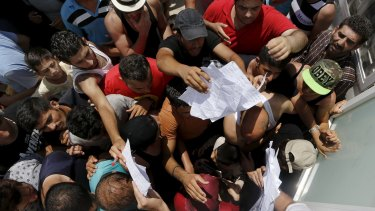 Syrian refugees push to get registered on the Greek island of Kos.