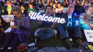 Thousands of people joined a candlelight vigil in Brisbane to show solidarity and welcome for Syrian refugees.