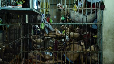 Prisoners inside a cell in Manila Police Headquarters, Philippines, most arrested  under tough drug laws.