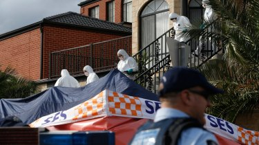 Police leave a Melbourne house which was raided as part of a counter terrorism operation.