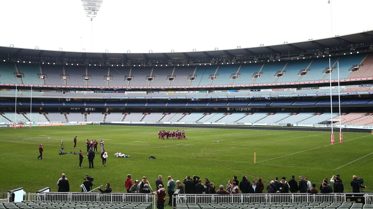 The Maroons huddle together during a training session at the MCG on Tuesday.