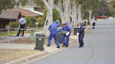 Forensic officers and police investigate a homicide in Knoke Ave, Gordon.