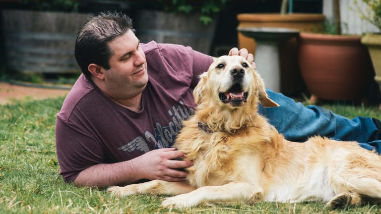 Dog of the year Jack with his owner Scott Gilbert at home in Evatt.