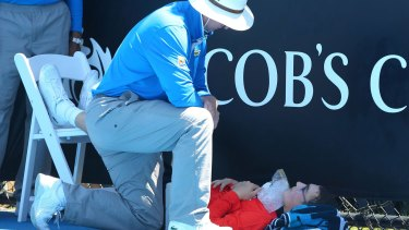 A ballboy faints at last year's Australian Open during a heatwave.