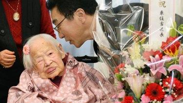 Misao Okawa at her 117th birthday celebrations with Takehiro Ogura, mayor of Osaka's Higashi-Sumiyoshi Ward, at an elder care facility in Osaka.