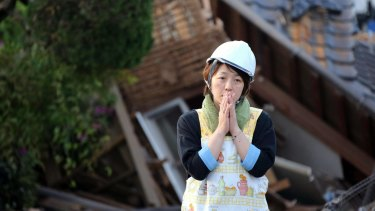 A resident in front of a damaged house in Mashiki, Kumamoto prefecture, in southern Japan on Saturday.