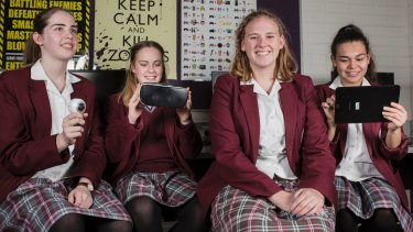 St Clare's College students Heather Mills 16, Erin Burk 15, Tylah Forsyth 17, and Kaylah Edwards 15. The school participated in a program aimed at improving maths outcomes.