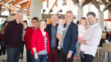 ACT Chief Minister Andrew Barr spends some time with his family at the aboretum: From left parents James and Susan Barr, sister-in-law Natalie Barr, partner Anthony Toms, Andrew Barr with nephew Angus, and brother Iain Barr with Zoe.