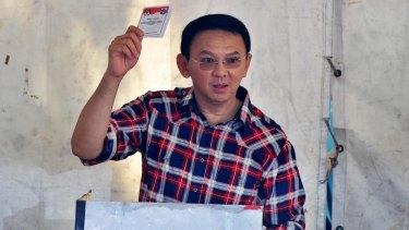 """Jakarta's governor Basuki """"Ahok"""" Tjahaja Purnama casts his ballot on Wednesday."""