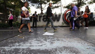 People walk past the site of Monday's bombing in central Bangkok.