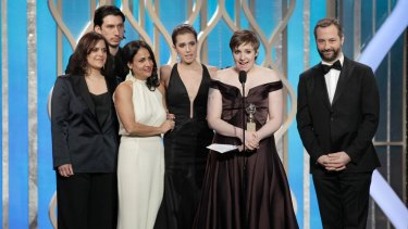 Lena Dunham, in Zac Posen, accepts the Best  Comedy or Musical award for Girls on stage during the 70th Annual Golden Globe Awards at the Beverly Hilton Hotel International Ballroom on January 13, 2013 in Beverly Hills, California.