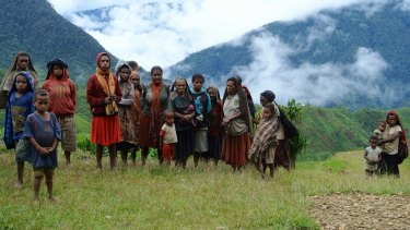 Wild side: Lolat villagers wait by their airstrip to greet the writer.