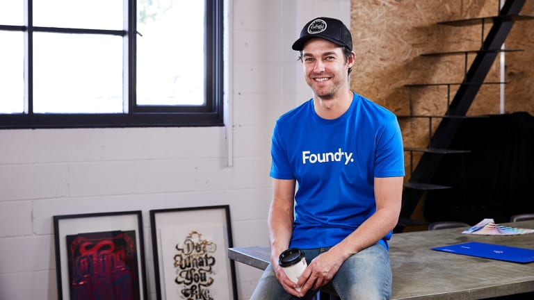 Designer Mat Colley said a six-month stint at the ATO inspired the very Canberran T-shirt.