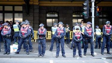 Police on Flinders Street on Wednesday afternoon.