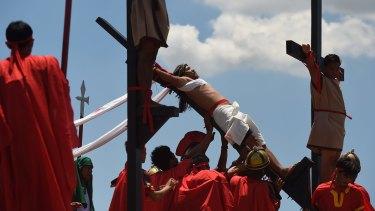 Reuben Enaje re-enacts Christ's crucifixion in Barangay San Pedro Cutud in Pampanga, north of Manila