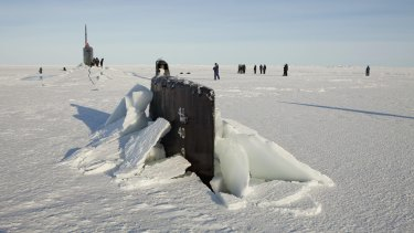 Resource rich area ... A congressional delegation and the Secretary of the Navy walk around the Seawolf class submarine USS Connecticut after the boat surfaced through through Arctic sea ice in 2011.