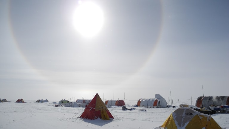 A solar halo above the Aurora Basin North campsite, 550 kilometres inland in Antarctica.