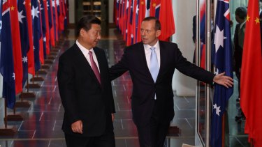Tony Abbott and Xi Jinping leave the House of Representatives on Monday.