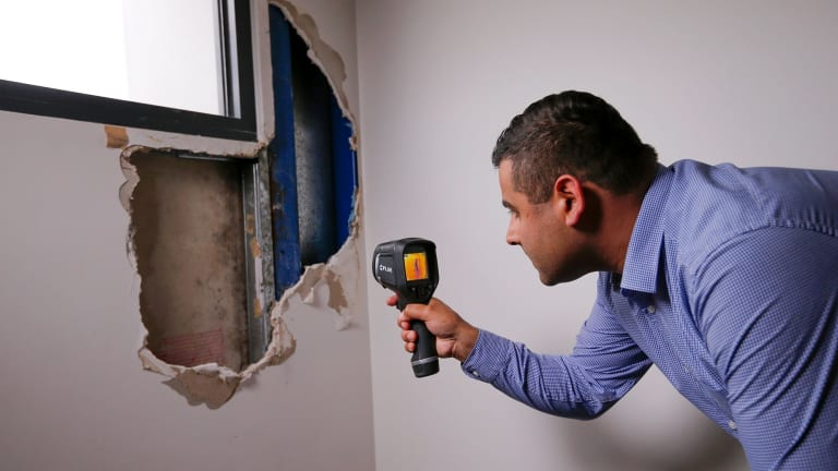 Building defects expert Sahil Bhasin inspects an apartment building that won design awards but now has major problems.