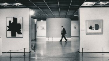 A NGV guard walks past the bare wall where Picasso's Weeping Woman had hung.