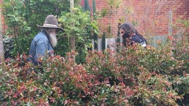 Costa Georgiadis and Greg Smith in the Rose Avenue garden.