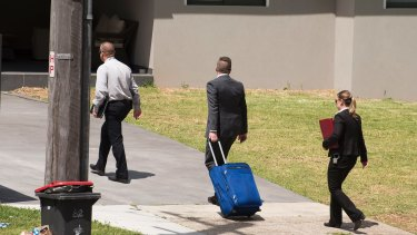 Detectives return to the crime scene at Georges Hall on Wednesday.