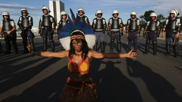 A Pataxo indigenous woman performs in front of a heavy police presence during protests in Brasilia last month.