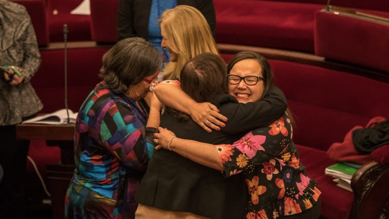 Emotional scenes in the upper house after the voluntary assisted dying laws passed.